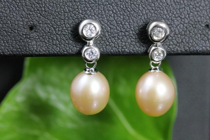 zilveren oorbellen met echte parels, natuurlijk roze tint