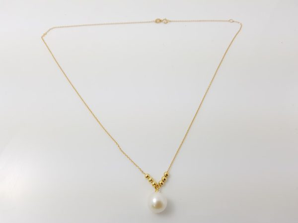 geelgouden ketting met parel en diamant