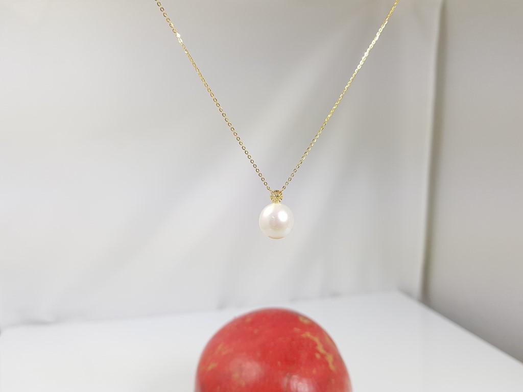 geelgouden ketting met echte parel en diamant