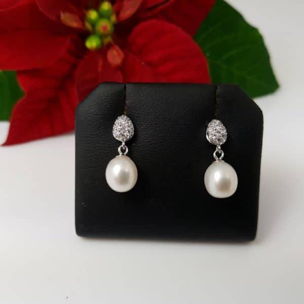 hangende zilveren oorbellen met echte parels