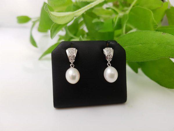 zilveren afhangende oorbellen met echte parels