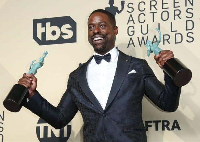 LOS ANGELES, CA - JANUARY 21: Actor Sterling K. Brown, winner of Outstanding Performance by a Male Actor in a Drama Series and Outstanding Performance by an Ensemble in a Drama Series for 'This Is Us,' poses in the press room at the 24th Annual Screen Actors Guild Awards at The Shrine Auditorium on January 21, 2018 in Los Angeles, California. (Photo by Dan MacMedan/Getty Images)