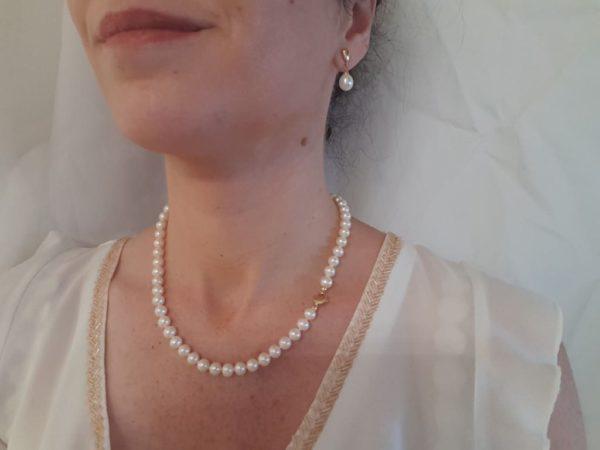 halsketting van ronde parels met gouden slot