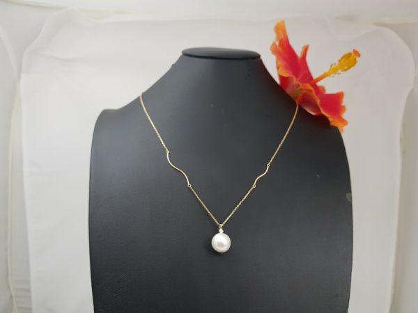 halsketting in 18k geelgoud met echte parel en diamant