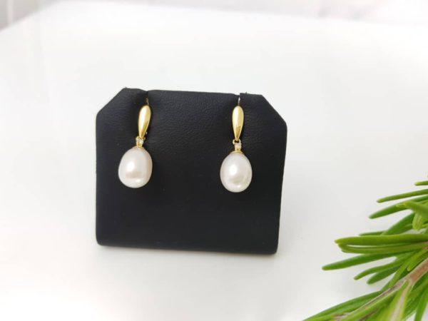 geelgouden pareloorbellen met diamant