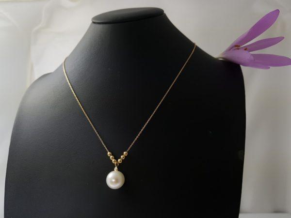 halsketting van geelgoud met echte parel en diamant