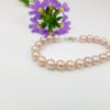armband van ronde roze parels