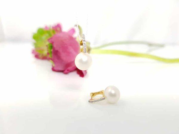 geelgouden oorbellen met parels en diamanten