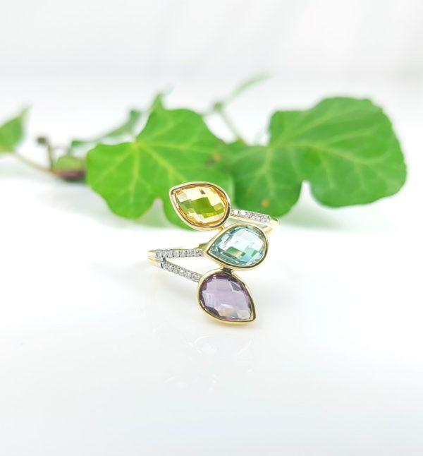 Gouden ring met diamanten en citrien, amethist en blauwe topaas.