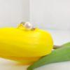 18k geelgouden parelring met diamanten.